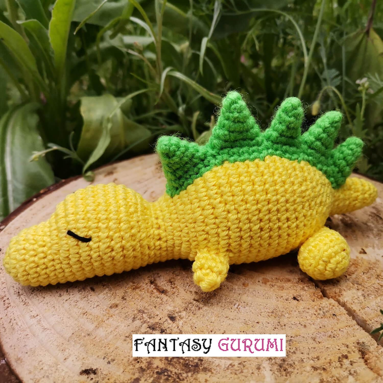 bébé t-rex jaune et vert