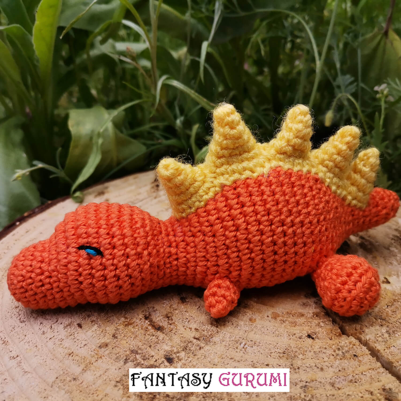 bébé t-rex orange et jaune